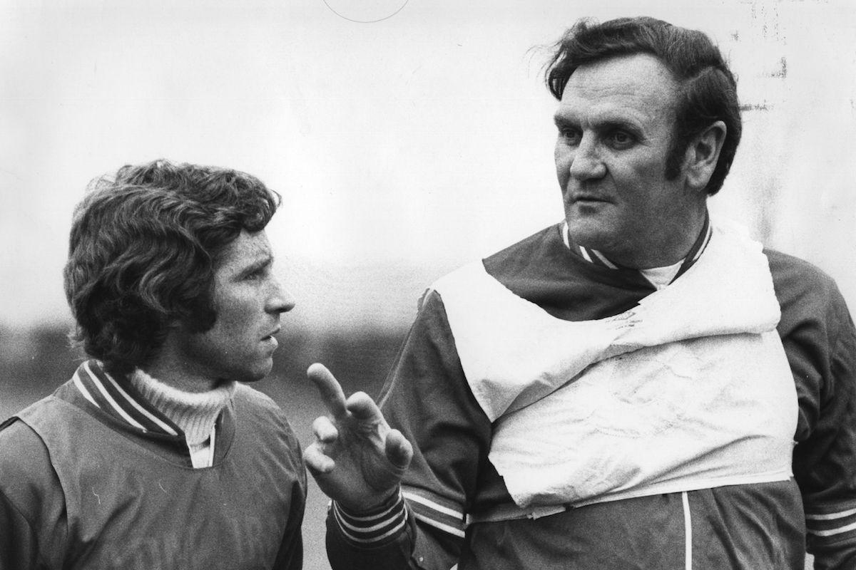 Alan Ball, the Arsenal football player and England's Captain listening to England manager Don Revie, who is advising him on the match against West Germany.  Original Publication: People Disc - HG0002   (Photo by Central Press/Getty Images)